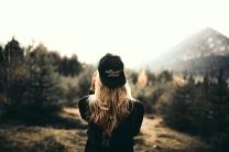 Woman back ballcap mountains
